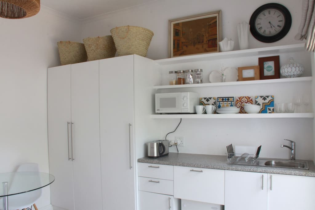 A kitchenette with microwave, 2-plate hotplate, toaster, kettle and fridge.  Fully kitted with cutlery and crockery. And, of course, complimentary tea, coffee, sugar and milk