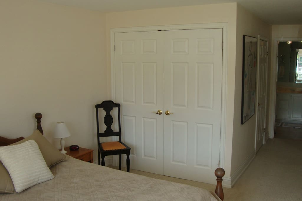Queen size bed in master bedroom and large closet