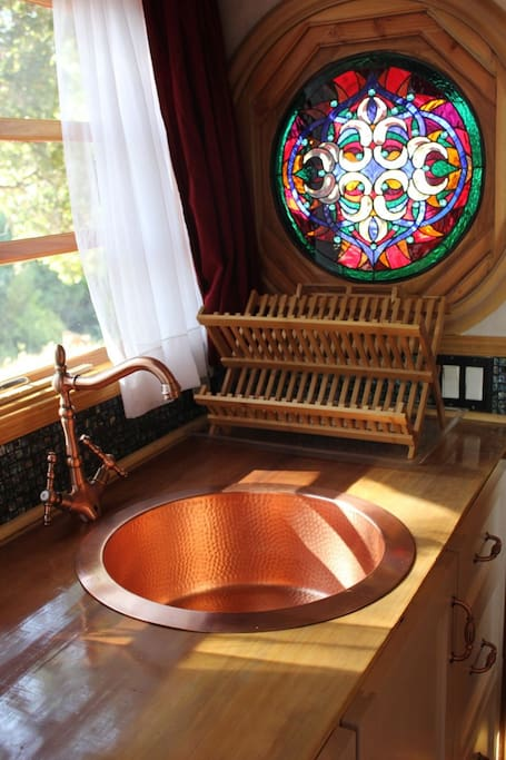 solid hammered copper sink in the sunlight