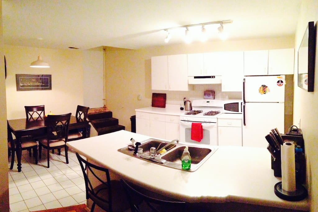 Full-service kitchen, dinner table, dish-washer, double-sink,  electric kettle, complete with cooking utensils and appliances