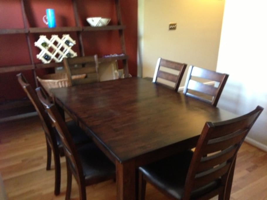 The dining room table has plenty of room to spread out if you decide to eat at home