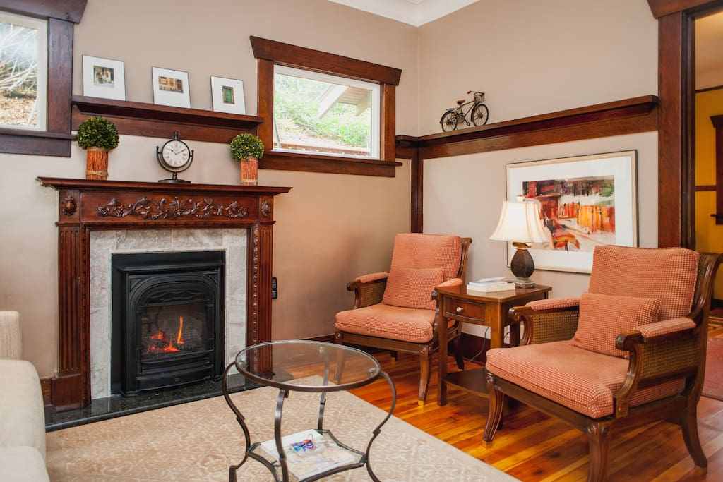 Antique cherry mantel and gas fireplace welcome you.