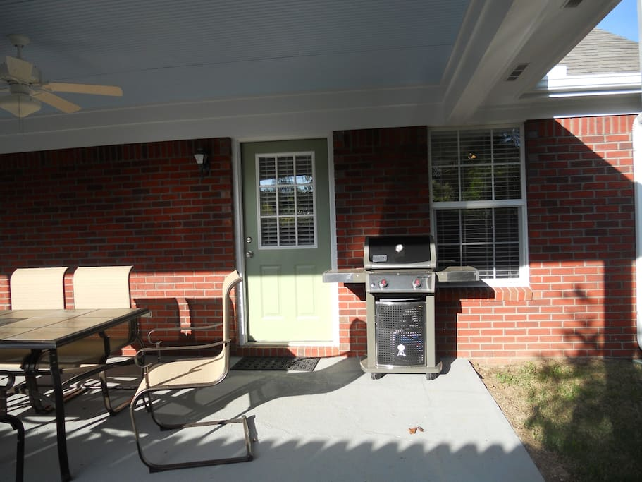Back Porch has Weber Grill and table and 6 chairs.