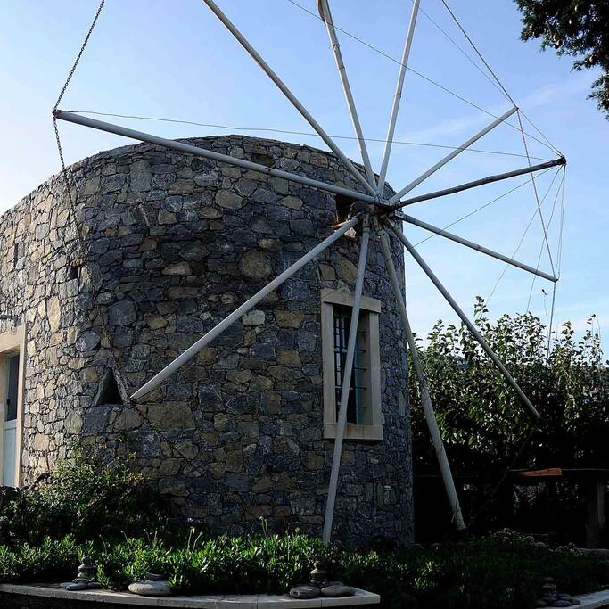 Cretan architecture with local stone blending perfectly with the surrounding environment