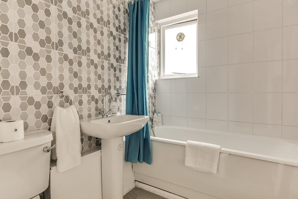 3.5 bathrooms with fluffy white towels and toiletries...