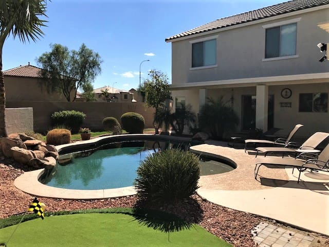 Heated pool, Outdoor fireplace and Putting green!