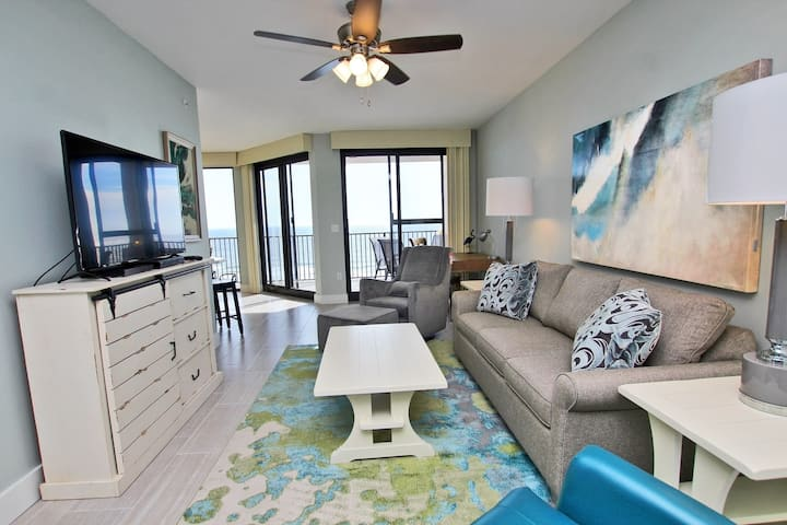 Phoenix X 808 - Next door to the Infamous Flora-Bama! Watch the Mullet Toss from your balcony! Indoor Pool, Outdoor Pool with Bridge, Grilling Area, Fitness Room, and More!  Right on the Beach!