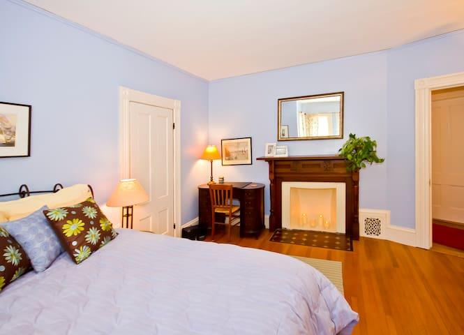 Plush Queen bed in relaxing guest BR with antiques and carved fireplace