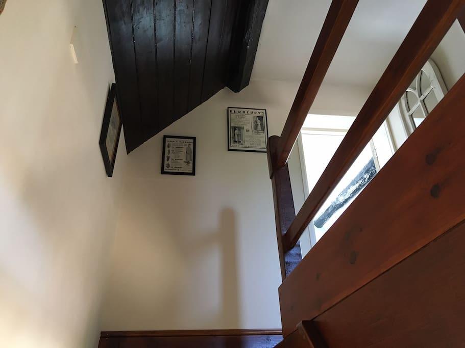 Looking upstairs. Beams throughout