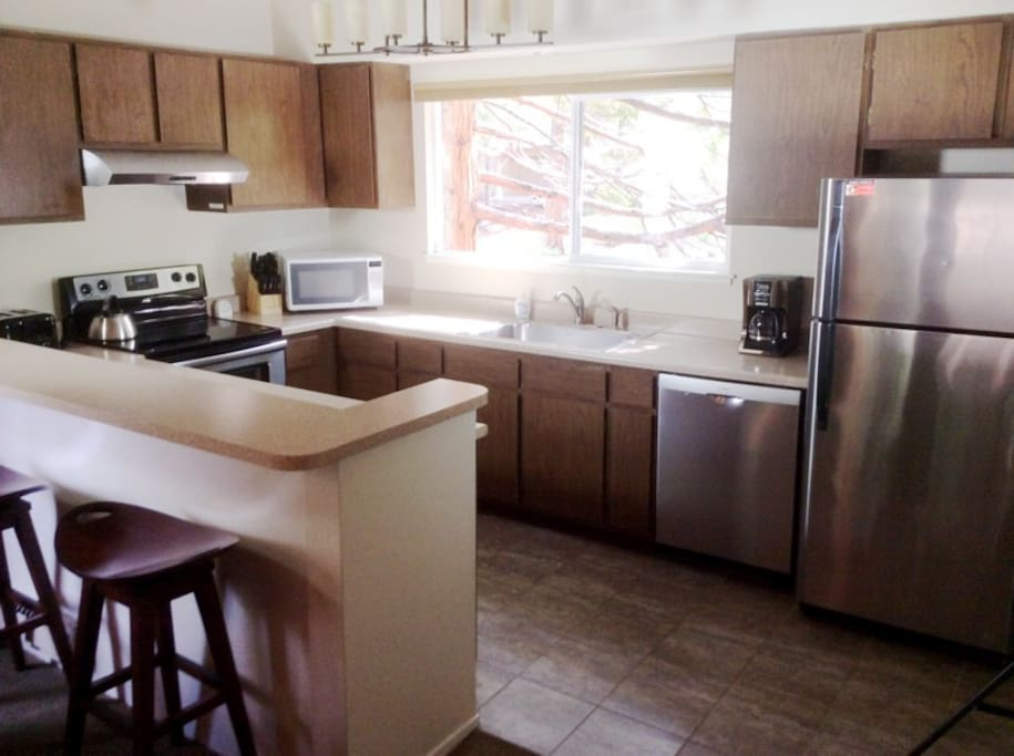 Open kitchen with bar stools, perfect for socializing while cooking.