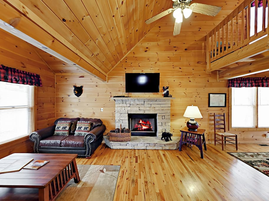Vaulted ceilings soar in the living room, complete with a cozy gas fireplace.
