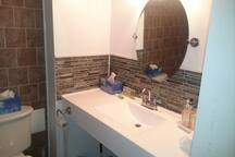Newly tiled bathroom.  Large Shampoo, conditioner and soap bars included With mini towels and other essentials.