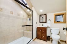 Beautiful bath with Large laundry in room next to it.