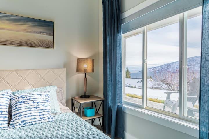 Cozy queen bedroom with views, blackout blinds, and ceiling fan.