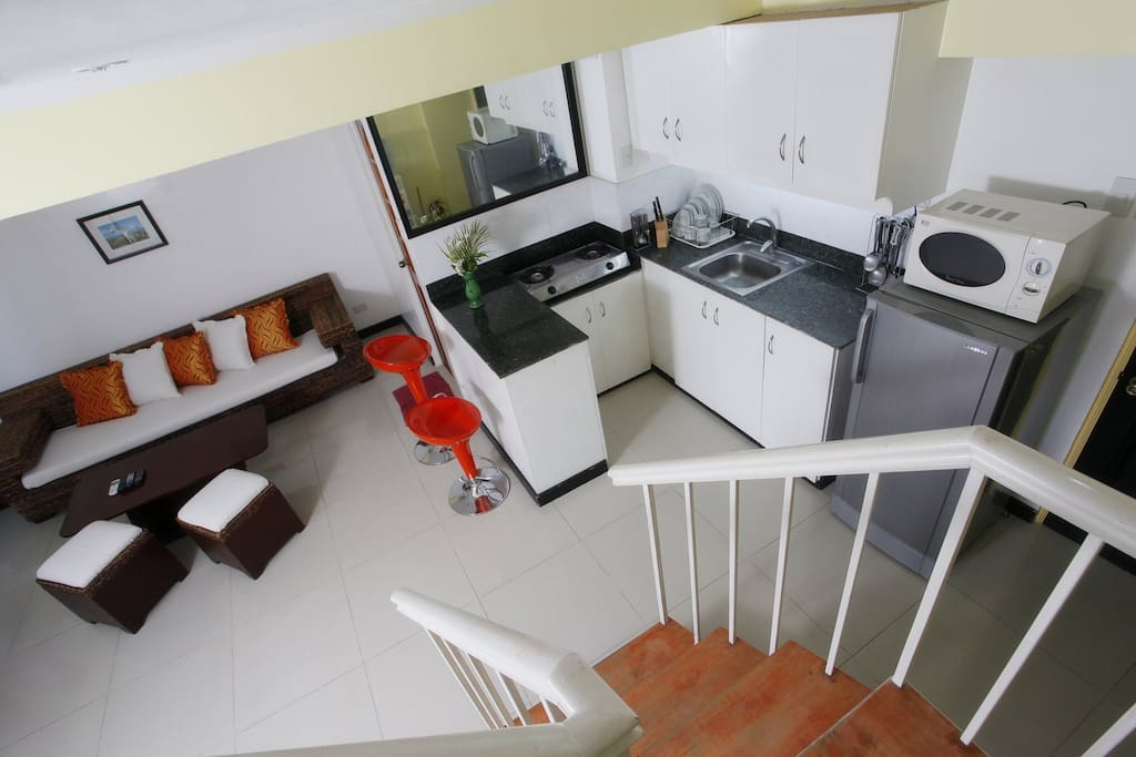 65 sqm apartment, view from the stairs. You can see the kitchen and living area