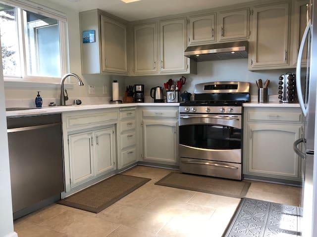 Kitchen w/ back deck view