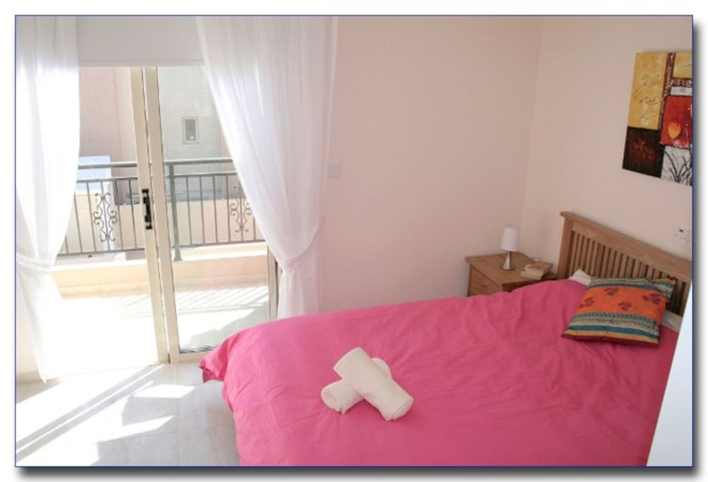 Master Bedroom, king-size double bed, en suite, air con and balcony.