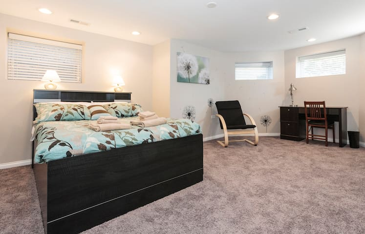 Spacious and bright, the Dandelion Room (BR-1) receives first morning light. It sleeps 2 people +  2 babies in 2 Pack-and-Plays available at your request. Each of 3 bedrooms is equipped with a privacy door that locks from inside each bedroom.