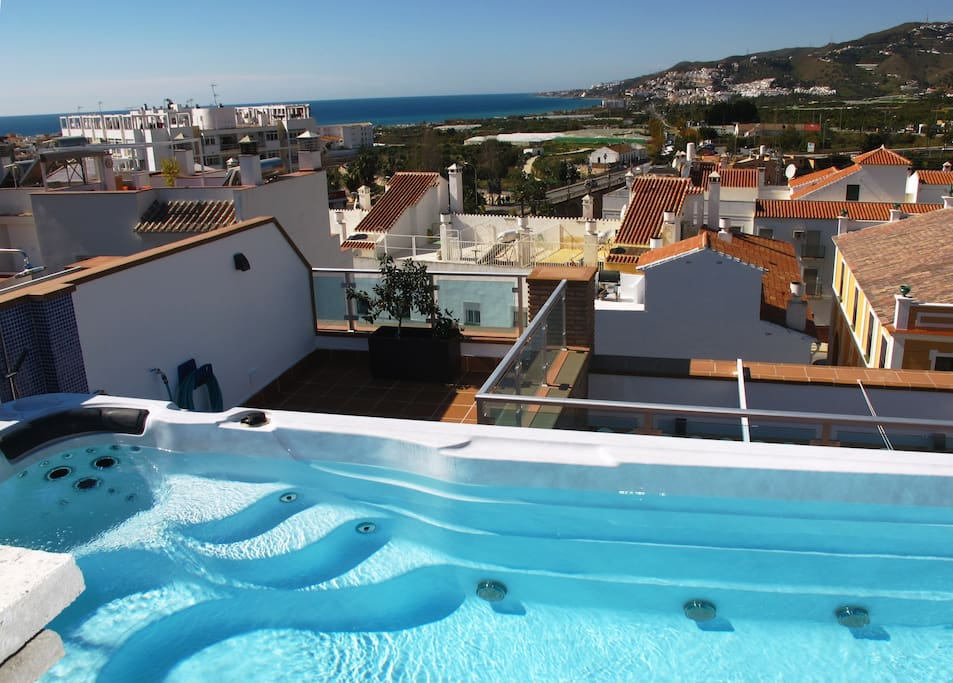 Big swim spah jacuzzi on roof terrace. Sea and mountain view.