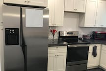 Modern full kitchen ready for you! Brand new range, microwave, coffee pot, toaster, blender, and dishwasher!