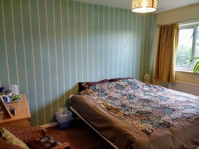 King size bedroom with parking in residential area