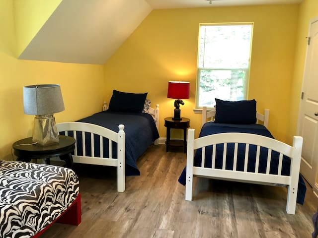 There's a pair of twin beds in the airy upstairs.