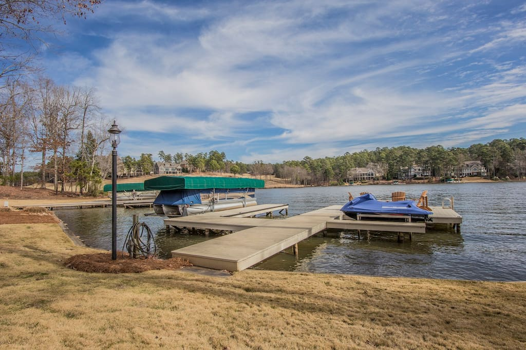 Private dock and adirondack chairs