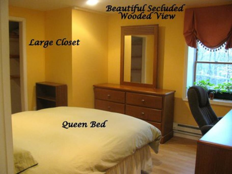 Bedroom #1 with queen size  bed, large desk, dresser, closet, wifi