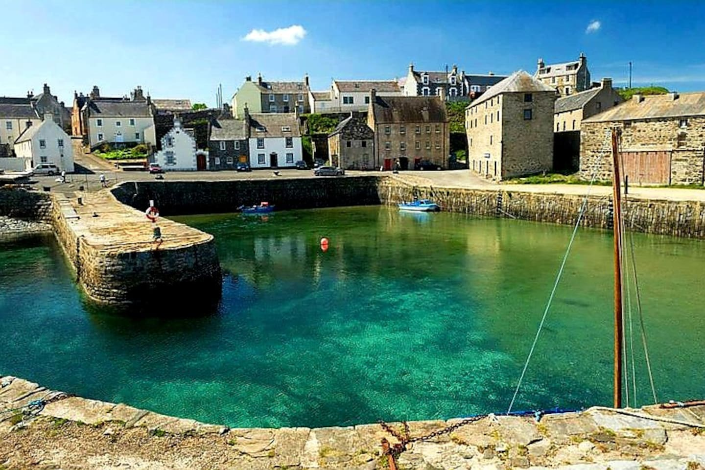 Portsoy harbour with the Old Merchant House in the right hand corner