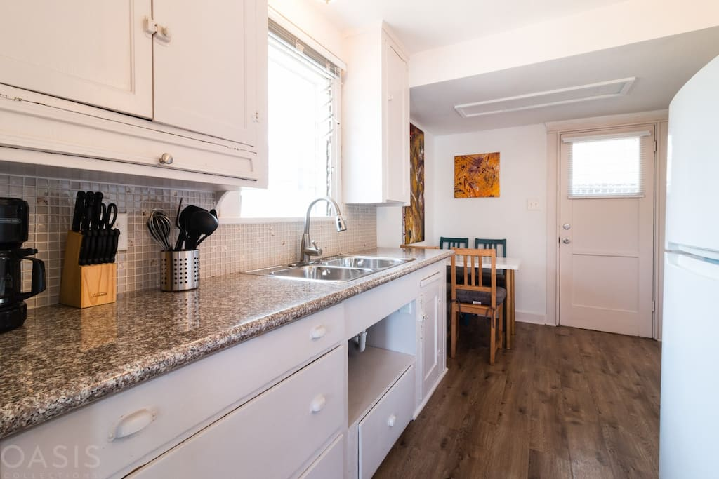 Updated kitchen, fully stocked for all your dining and cooking needs!