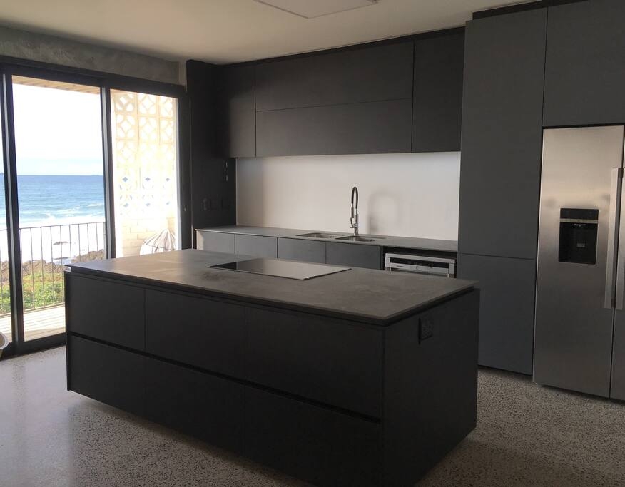 A state of the art kitchen - hob, oven, microwave, dishwasher, fridge and coffee machine