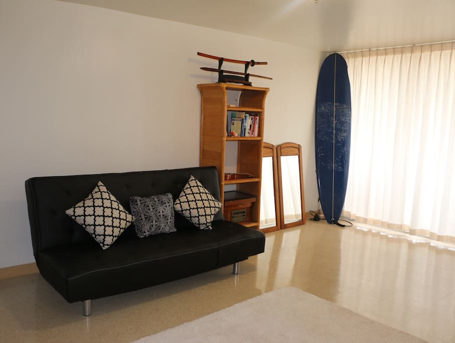 This is the living room. I have surfboards that you can use!