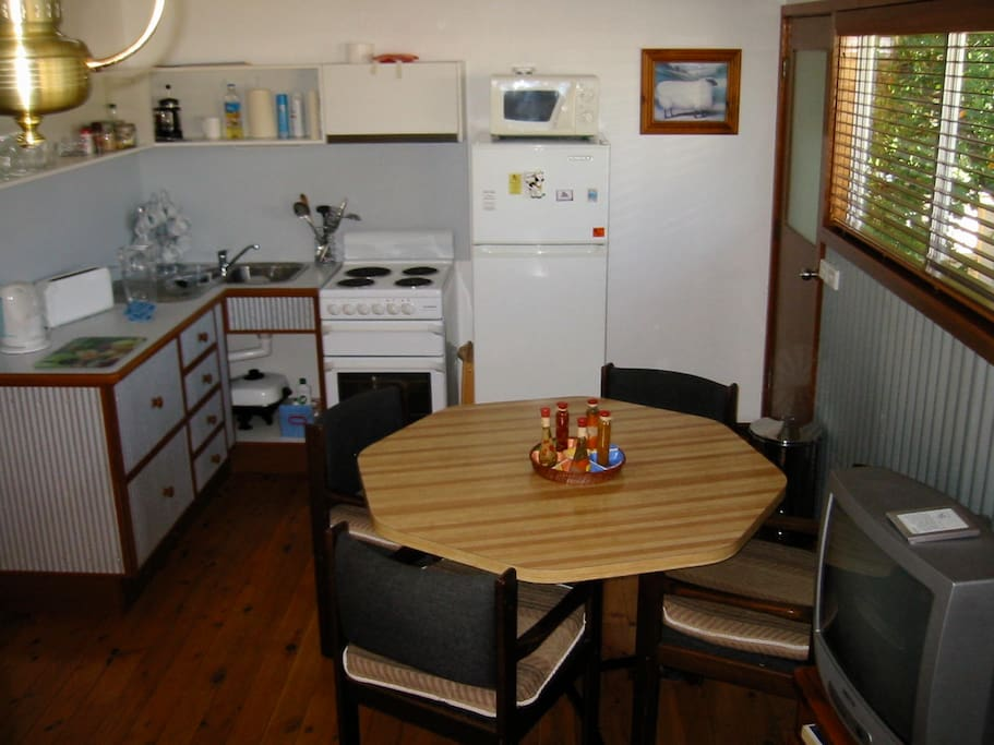 self-contained kitchen, dining, living areas