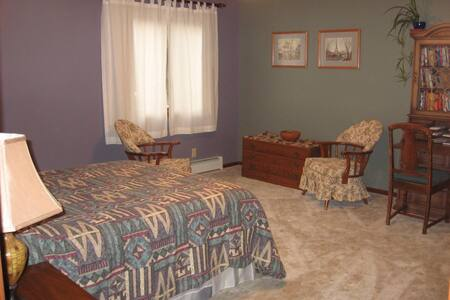 Master bed room with full bath, double sink, walk-in closet, garden view, queen bed.