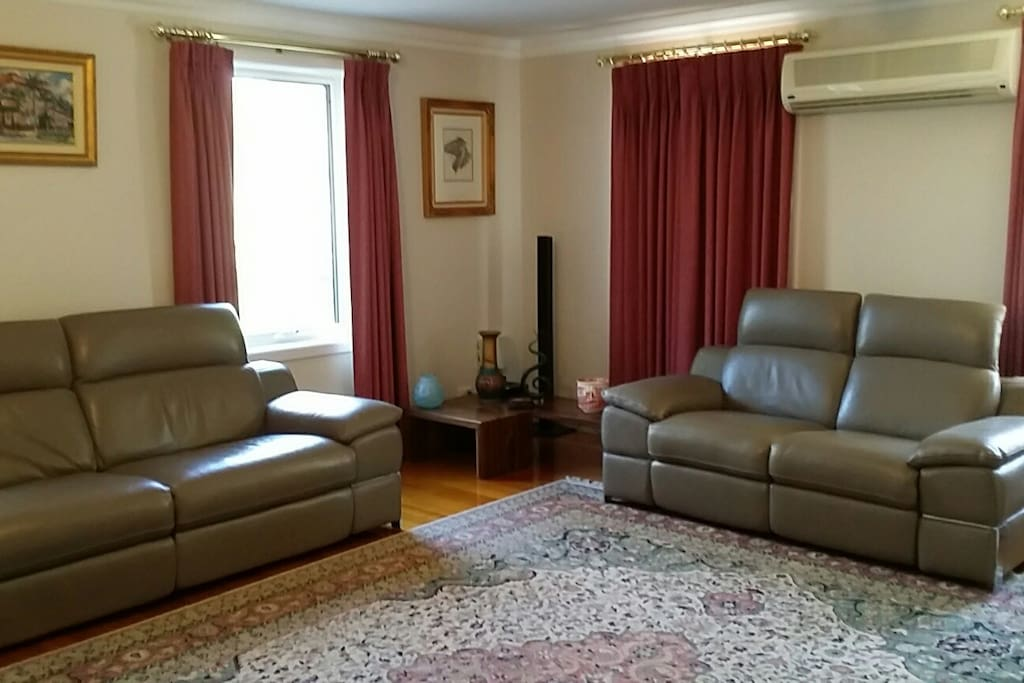 Large lounge room with aircon, 42 in flatscreen TV, Bluray player and surround sound to relax and watch a movie at the end of the day.
