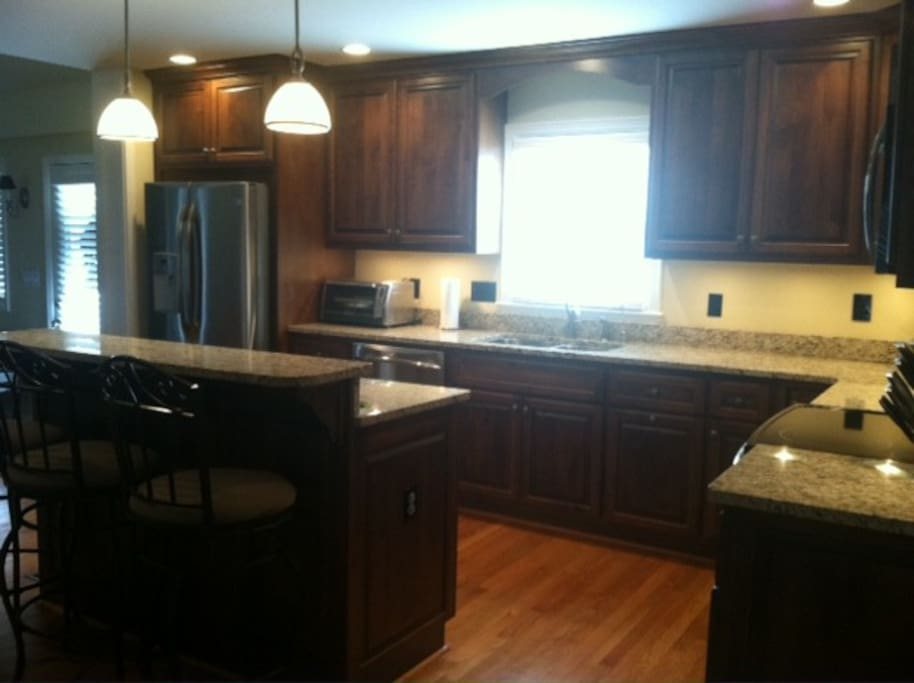 Eat in kitchen with granite counter tops and stainless steel appliances