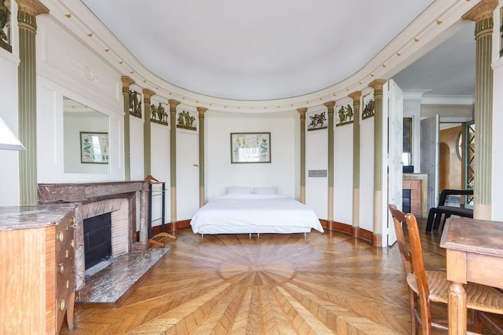 Oval bedroom with king size bed