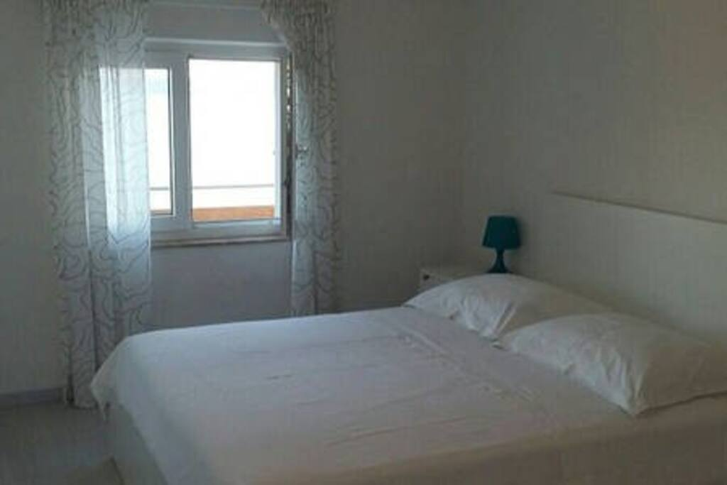 First bedroom; double bed 160x200, sea view, air condition, wardrobe, writing table..
