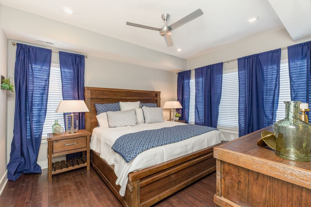 The king-size bed in the master bedroom