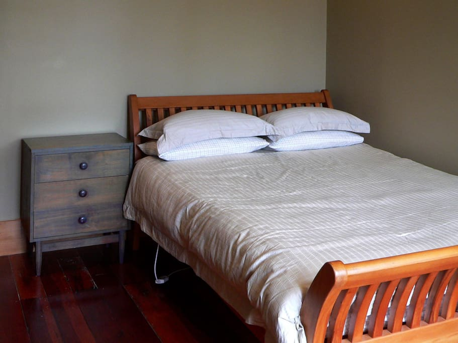 The bed, nice and comfy, with electric blankets. The floor is matai, a New Zealand native hardwood. It's 90 years old so it has a bit of character.