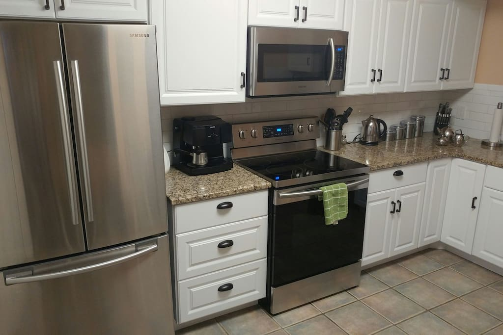 Brand new white kitchen cabinets with granite countertops and new Samsung Appliances.