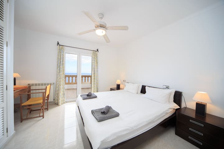 A bedroom with air conditioning