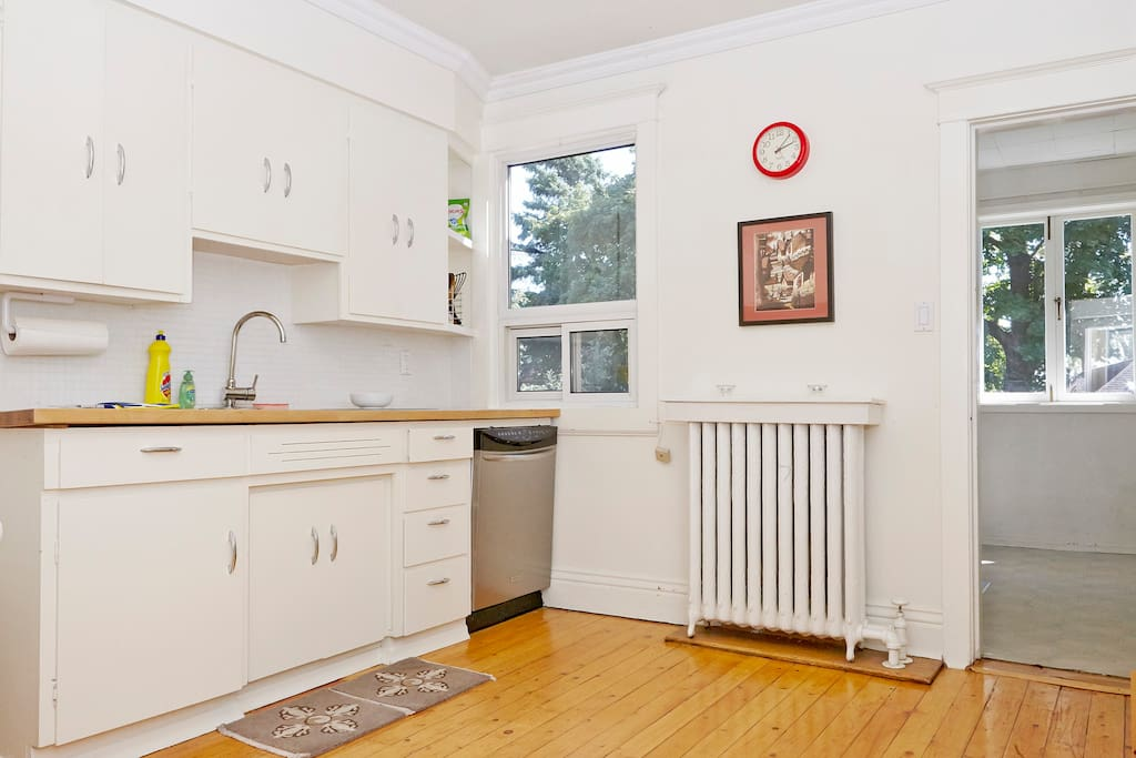 Big bright kitchen with classic knotty-pine floor, pot-lights, ss dishwasher, quiet back office room with big window and a door that closes for privacy.