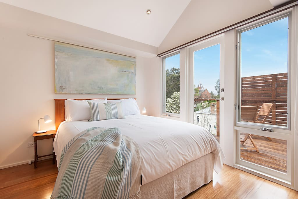 Master bedroom with Queen bed and doors to balcony
