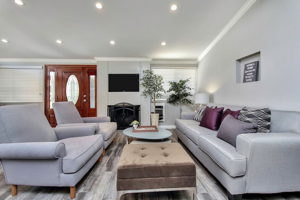 Comfy cushions for everyone to watch cable on a flat screen/smart TV. See the cute fireplace? It's real!