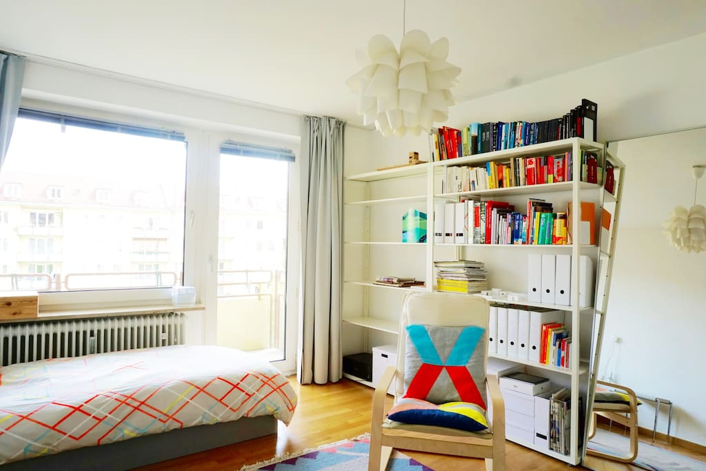 The furniture & decor has some bright colored items that transform the apartment into a cozy home.