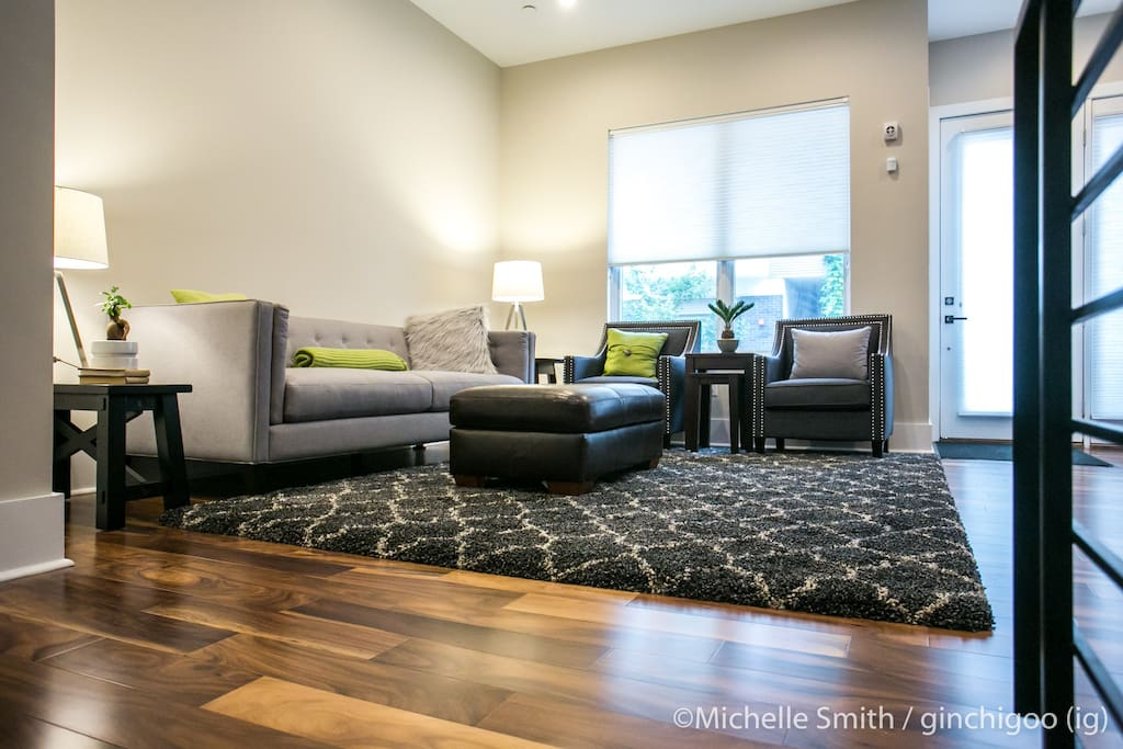 """Main living room. 55"""" 4K TV Sonos speakers in ceiling."""