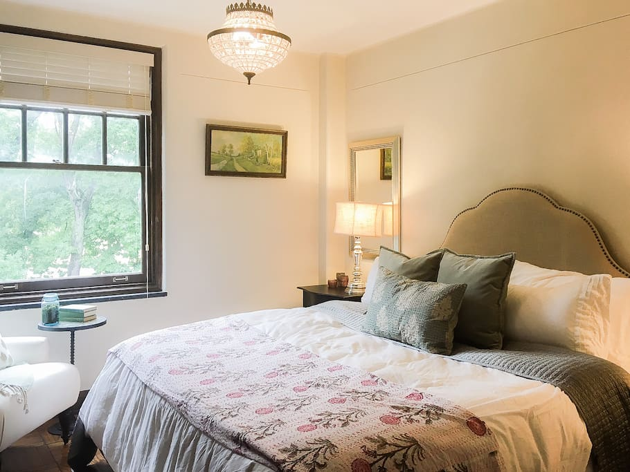 Photo of the Suite. There's a king sized bed, cozy seating, and lots of vintage inspired design.
