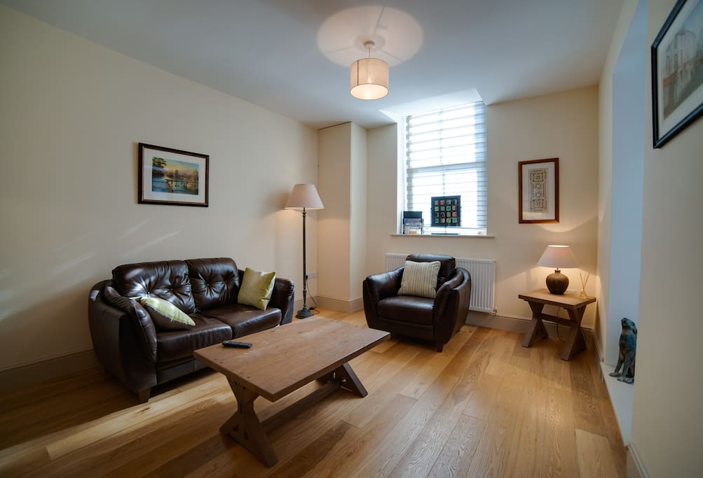 Beautifully furnished living area with local artwork on the walls.