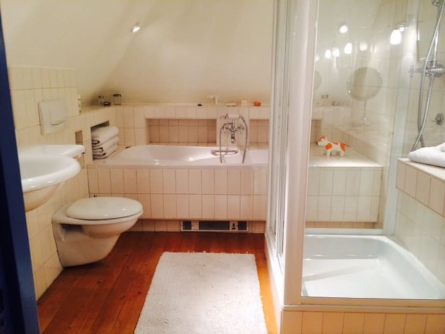 Luxury bathroo with whirlpool, rain shower and bathrobes for our guests.